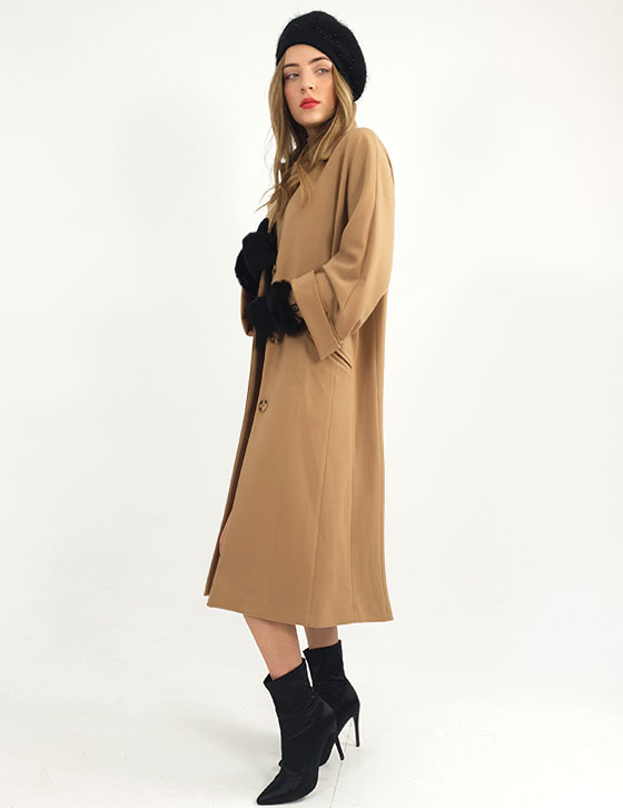 A woman standing in front of a coat