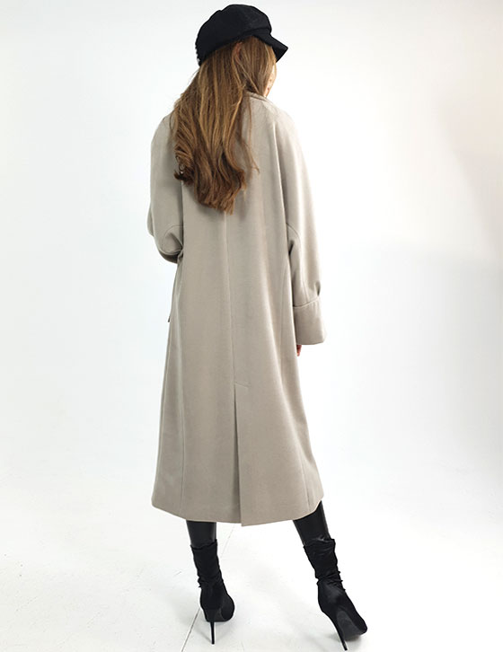 A person standing in front of a coat