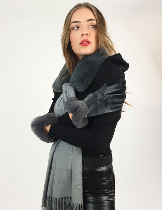 A woman wearing a costume posing for the camera