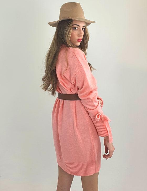 A woman wearing a pink dress