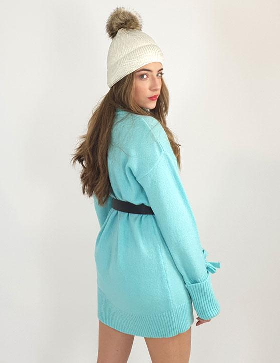 A woman wearing a blue dress